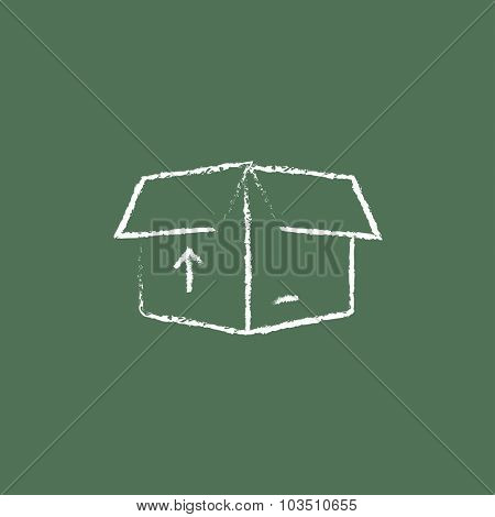 Open box with arrow hand drawn in chalk on a blackboard vector white icon isolated on a green background.