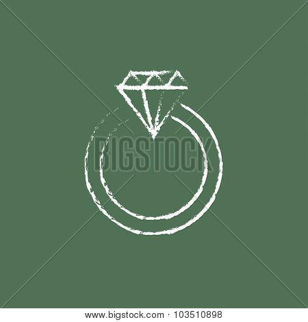 Diamond ring hand drawn in chalk on a blackboard vector white icon isolated on a green background.