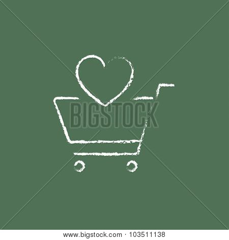 Shopping cart with heart hand drawn in chalk on a blackboard vector white icon isolated on a green background.