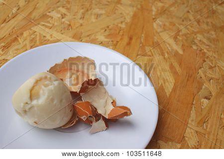 Boil Egg In White Plate On Wooden Background.