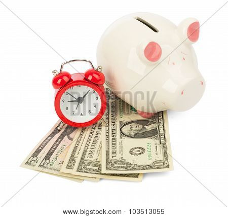 Piggy bank with dollars and alarm clock