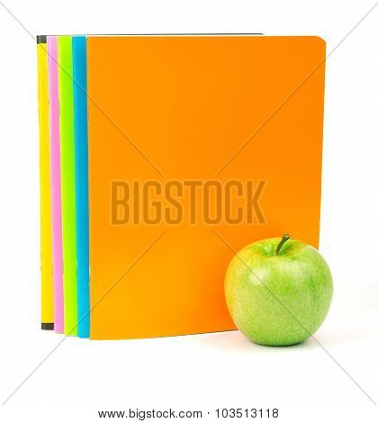 Fresh apple with exercise books