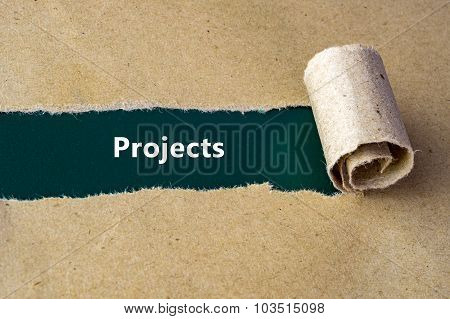 Torn Brown Paper On Green Surface With