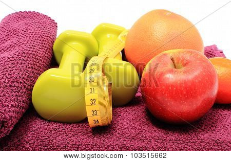 Fresh Fruits, Tape Measure And Green Dumbbells On Purple Towel