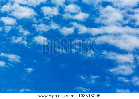 Peaceful white clouds at deep blue sky