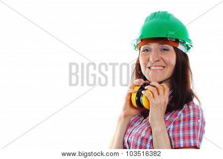 Woman Wearing Protective Helmet And Headphones