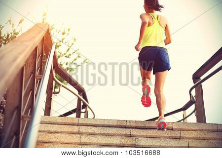 fitness sports woman running on stairs seaside