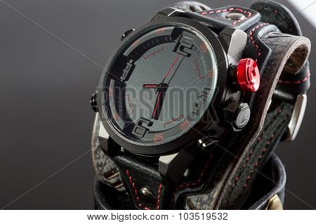 close-up of wristwatch on a black background