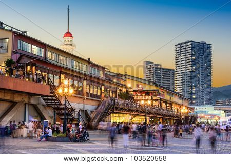 KOBE, JAPAN - AUGUST 14, 2015: Crowds in front of the Mosaic shopping complex at Harborland in Kobe.