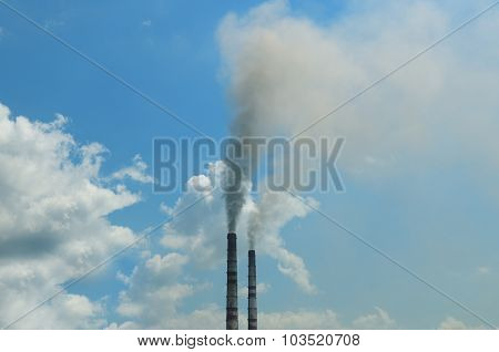 Smoke From The Pipes Against The Blue Sky