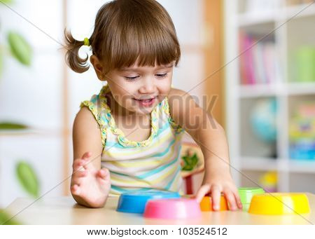 kid little girl playing with toys indoors
