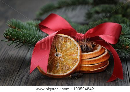 orange and anise with fir twig and ribbon bow