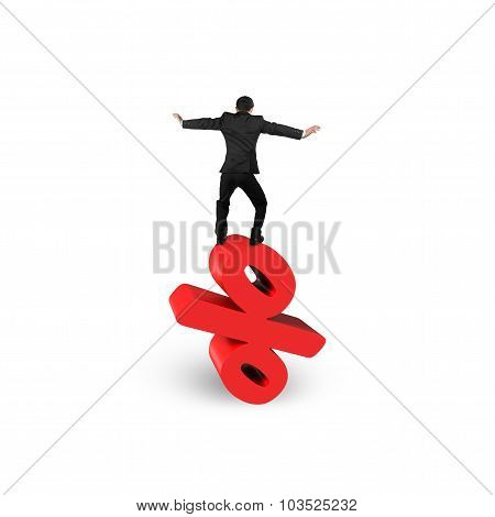 Businessman Balancing On Red Percentage Sign