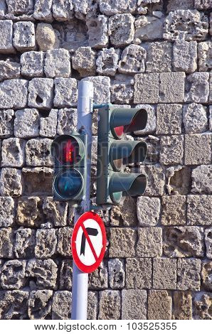 Traffic Lights Against Old Stone Wall In Greece