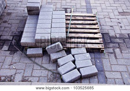 Pallet With Few Rows Of Concrete Grey Pavement Blocks