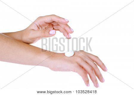 Beautiful women hands applying cream isolated on white