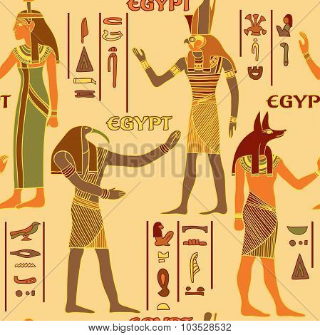 Vintage seamless pattern with egyptian gods and ancient egyptian hieroglyphs. Retro hand drawn vecto