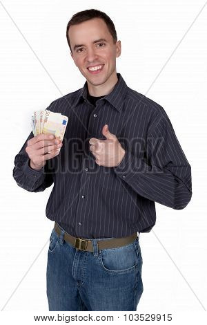 Young man holding money in his hand and shows thumb up