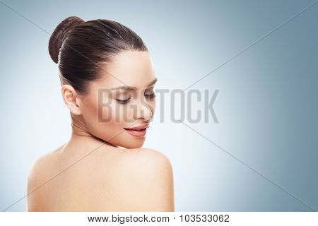 Beautiful Face Of Young Woman With Clean Skin On A Blue Gray Background