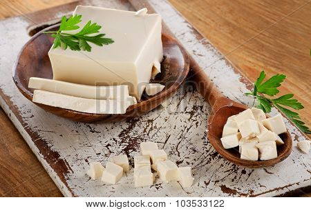Soy Tofu On A Wooden Table.