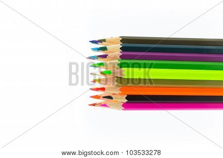 Group of rainbow colours wooden pencil on white background