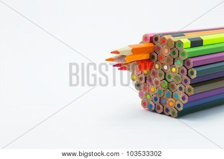 Group of colour wooden pencils on white background
