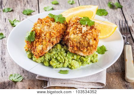 Baked Cod Fish In Breadcrumbs With Mashed Green Peas And Broccoli