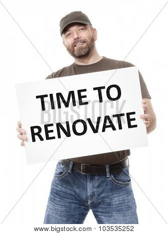 A bearded man holding a white board with the message time to  renovate