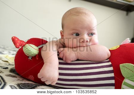 Thinking Newborn Baby Boy Lying On A Crawling Roll