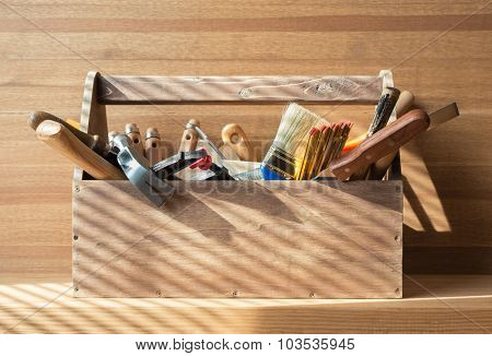 Wooden toolbox with carpentry tools on the shelf