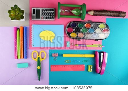 Bright stationery objects on table close up
