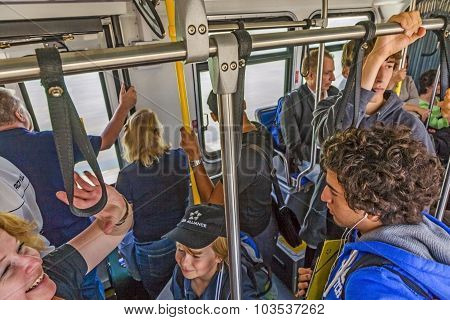 People In The Bus On The Way To The Aircraft