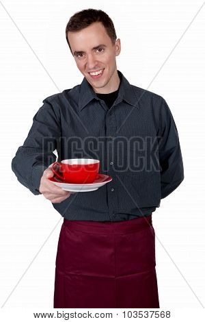 Handsome man offering a cup of coffee