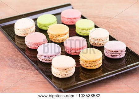 Colorful macarons on a lacquer tray