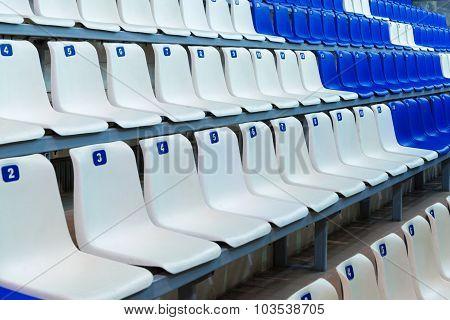 Sport tribune with empty chairs