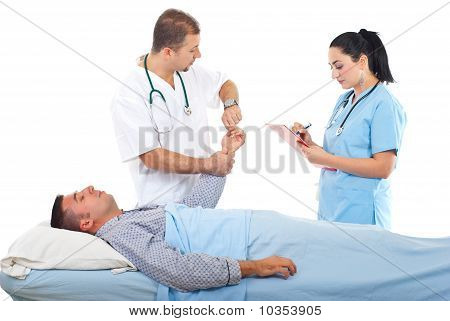 Doctor Taking Patient Pulse