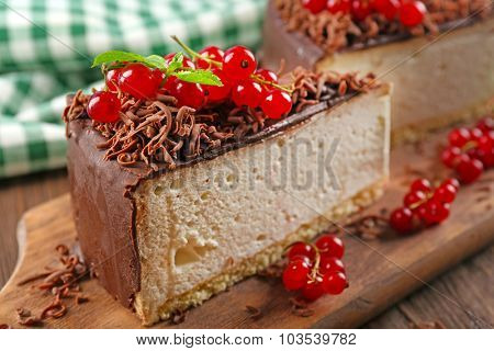Delicious cheesecake with berries on table close up