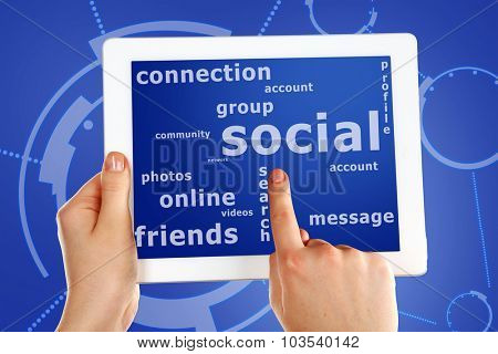 Social network and connected words on touch screen tablet-pc with finger touching screen, close up