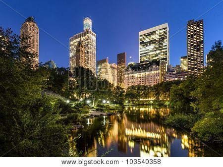 Central Park Pond And Illuminated Manhattan Skyscrapers, New York