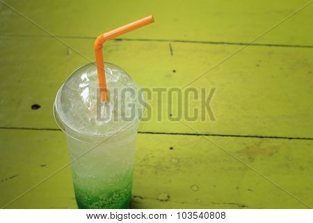 Green Fruit With Soda Water On A Table.