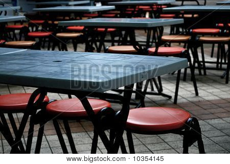 Empty Tables and Chairs