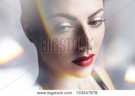 Beauty Woman's Portrait View Through Illuminated Glowing Bokeh Circles.