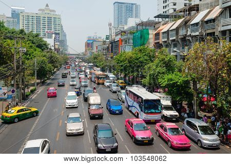 Busy Traffic On A Typical Urban Street In Downtown Bangkok, Thailand