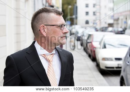 Portrait Of Businessman Standing In The Street