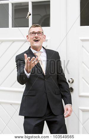 Man Throwing Keys In The Air