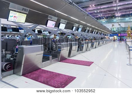Airline Employees Preparing To Serve Customers At The Departure Check In Counter Of Suvarnabhumi Air