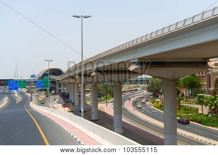 Elevated, Monorail Train Track Along A Major Metropolitan Highway In Dubai, Uae.
