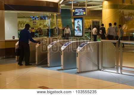 Interior Of A Monorail Commuter Train Station With Automated Turnstyles In Urban Dubai.