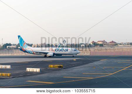 Fly Dubai Passenger Jet Taxiing To The Terminal After Landing At Dubai International Airport.