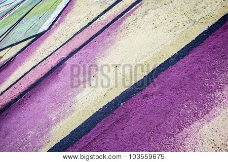 colorful abstract, a detail of a graffiti painted on a rough concrete wall